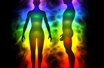 Aura, healing energy, extrasensory perception - woman and man silhouette